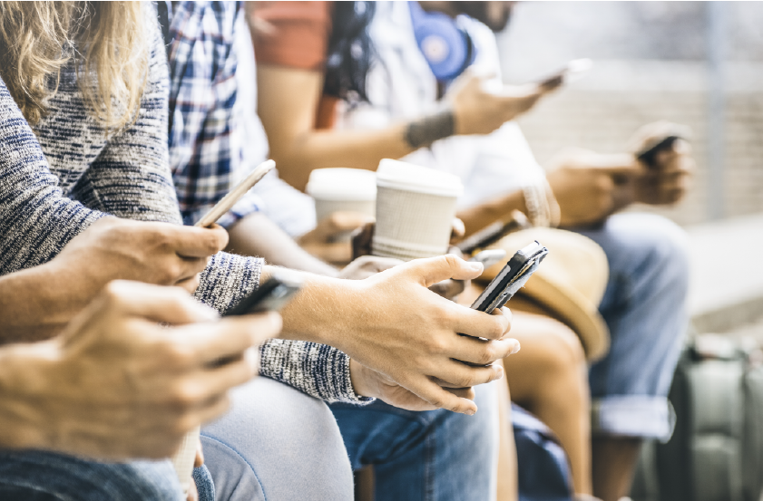 A Row Of People Texting
